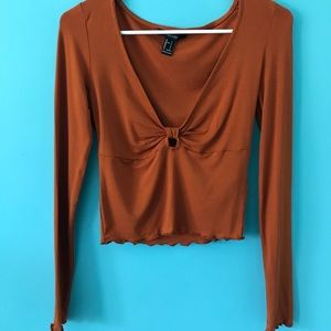 Deep cut burnt orange crop top